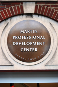 """A brown circle with the words """"Martin Professional Development Center"""""""